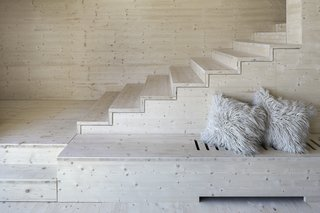 A built-in bench along the stairs offers a quiet spot for reflection.
