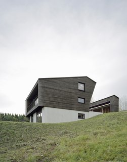 Concrete and wood create a two-toned exterior.