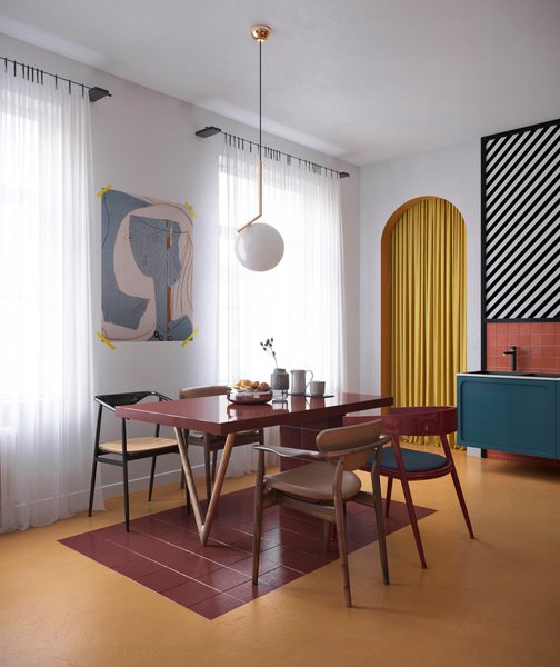 In the dining area sits Finn Juhl 109 chairs, a bespoke table, as well as a chandelier from Flos. There is also a Le Corbusier painting on the wall.