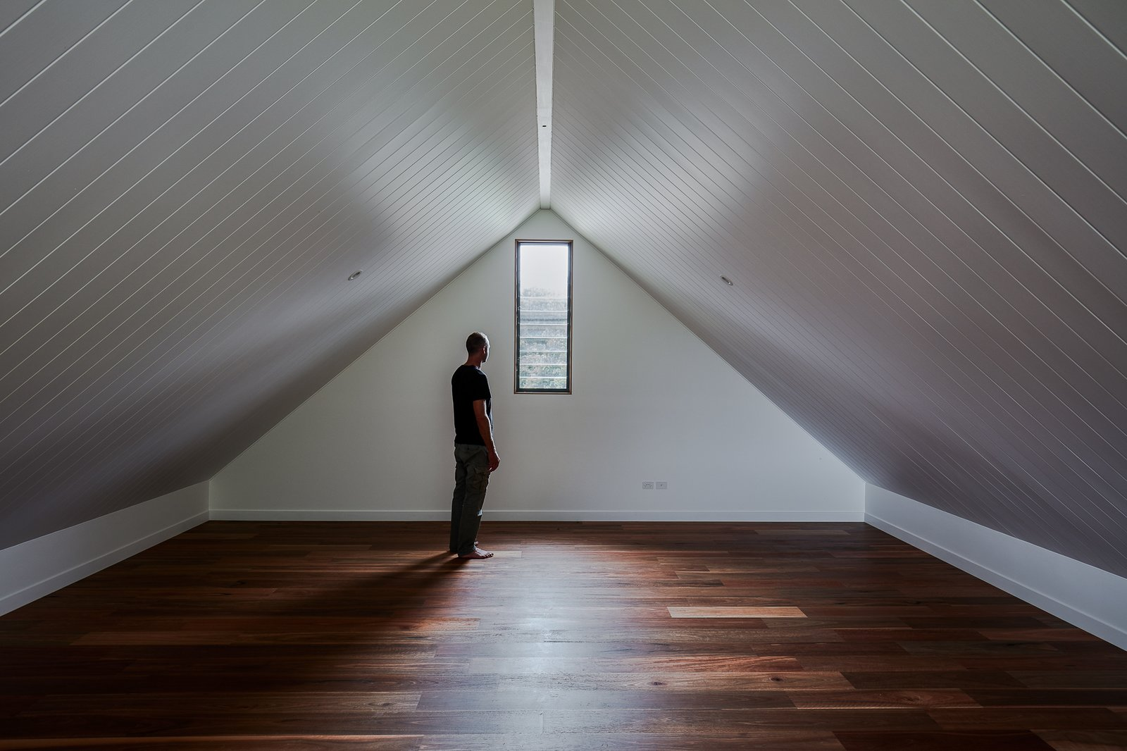 Shed & Studio and Living Space Room Type A snug attic room.  Photo 17 of 19 in Two Barn-Like Volumes Make Up This Low-Maintenance Australian Home