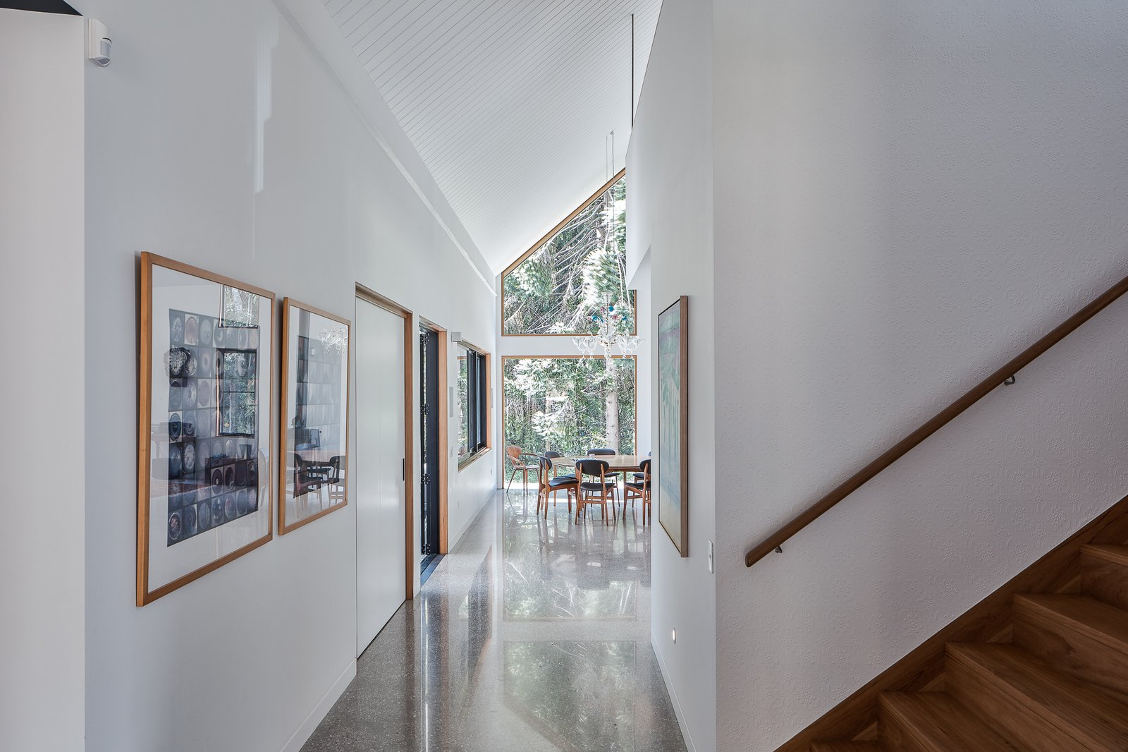 Hallway and Concrete Floor Plasterboard internal walls.  Photo 11 of 19 in Two Barn-Like Volumes Make Up This Low-Maintenance Australian Home