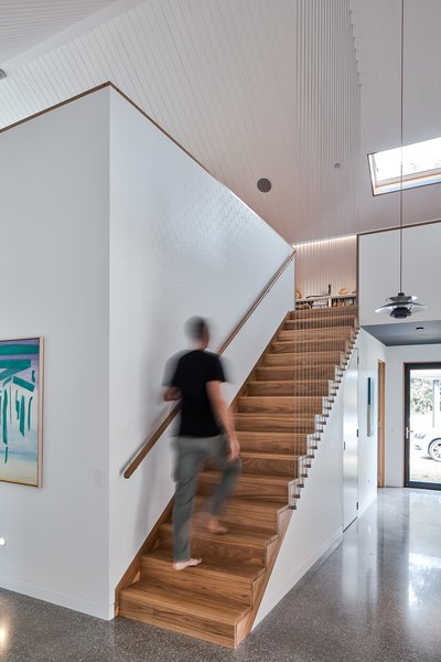 A staircase leads up to the mezzanine loft.