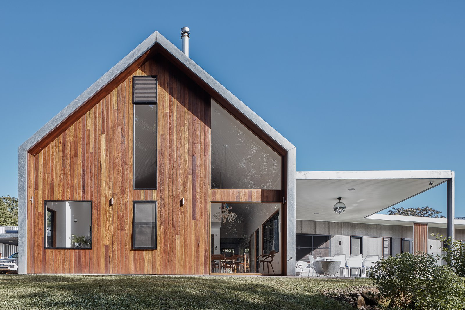 Exterior, Metal Roof Material, Metal Siding Material, House Building Type, Gable RoofLine, and Wood Siding Material A hidden portal steel frame provides strong support.  Photo 7 of 19 in Two Barn-Like Volumes Make Up This Low-Maintenance Australian Home