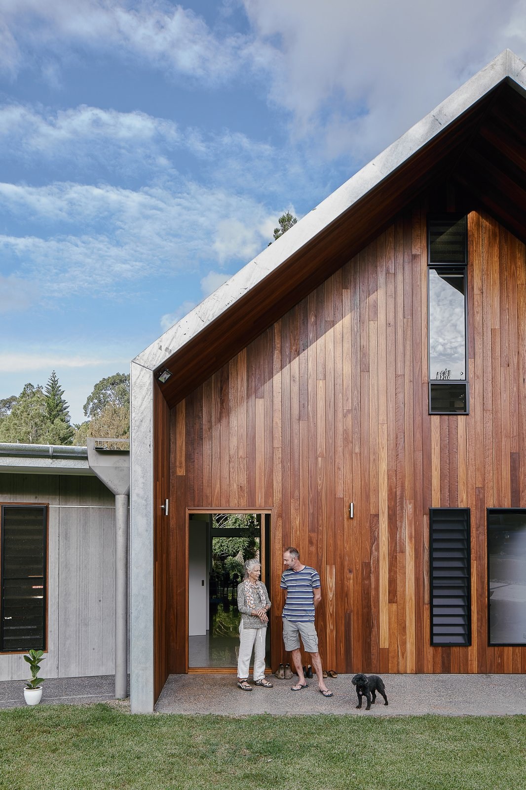 Exterior, House Building Type, Wood Siding Material, Metal Roof Material, Gable RoofLine, and Metal Siding Material Australian spotted gum wood was used for sections of the exterior wall.  Photo 9 of 19 in Two Barn-Like Volumes Make Up This Low-Maintenance Australian Home