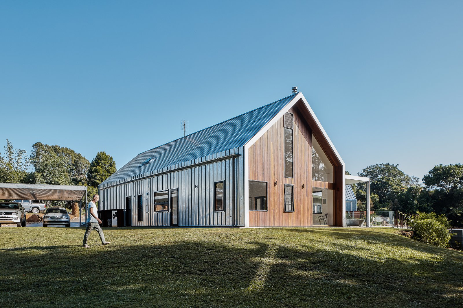 Exterior, Gable RoofLine, Metal Roof Material, House Building Type, Wood Siding Material, and Metal Siding Material A car port same the same galvanized metal roof as the house.  Photo 8 of 19 in Two Barn-Like Volumes Make Up This Low-Maintenance Australian Home