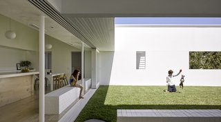 Direct connections from the interior to the courtyard allow the parents to keep and eye on their children as they peacefully play.