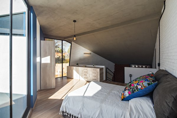 A look at the master bedroom located on the mezzanine level.