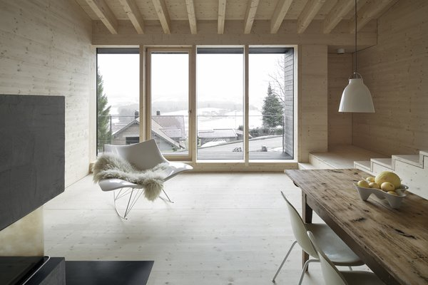 The open-plan living area looks out to stunning alpine views.