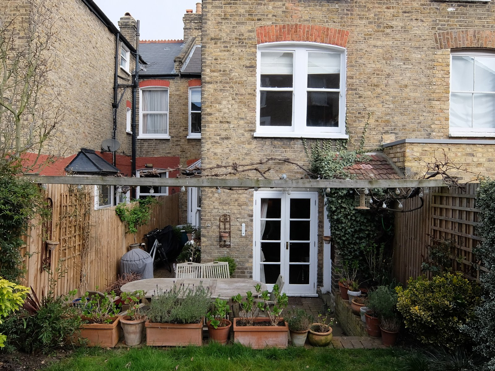 Before: the backyard    Photo 2 of 14 in Before & After: A London Home Doubles as a Cheery Work Space