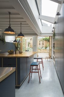Skylights dramatically brighten the kitchen.