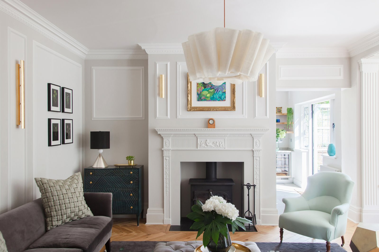 Living Room, Lamps, Medium Hardwood Floor, Console Tables, Table Lighting, Chair, Sofa, Pendant Lighting, and Hanging Fireplace Another Pinch pendant light in the living room.    Photo 11 of 16 in An English Arts and Crafts Home Becomes Delightfully Modernized