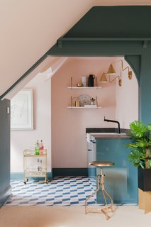 A small kitchen is located in the attic, and has been largely decorated with IKEA furnishings.