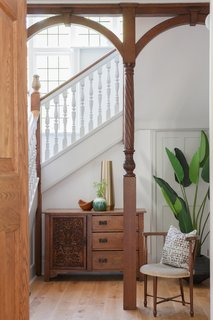 The designers/owners kept the home's original Arts and Crafts style posts.