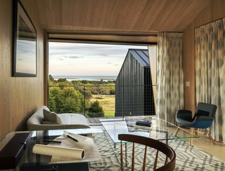 The lower spaces of the house give onto the meadow and its private world, while the upper spaces open to the long views across Chilmark's fields, ponds, and the Atlantic.