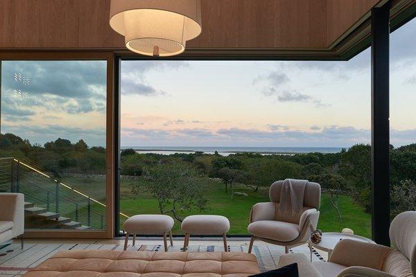 Glass sliding doors by Bayerwald Fenster Hausturen offer a portal to the outdoors.