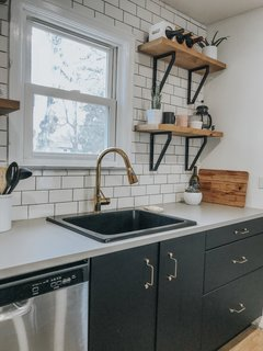 """The Elkay Quartz Classic 25"""" L x 22"""" W drop-in kitchen sink runs $240. The """"Wire"""" range hardware is from Superfront.com."""