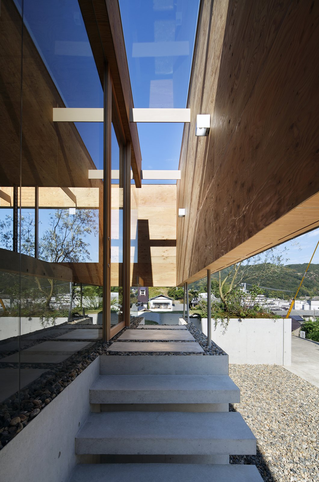 Staircase and Concrete Tread A glass ceiling shelters steps leading to the entrance.  Photo 6 of 12 in This Japanese Home Has a Sunken Interior That Blends Into the Earth