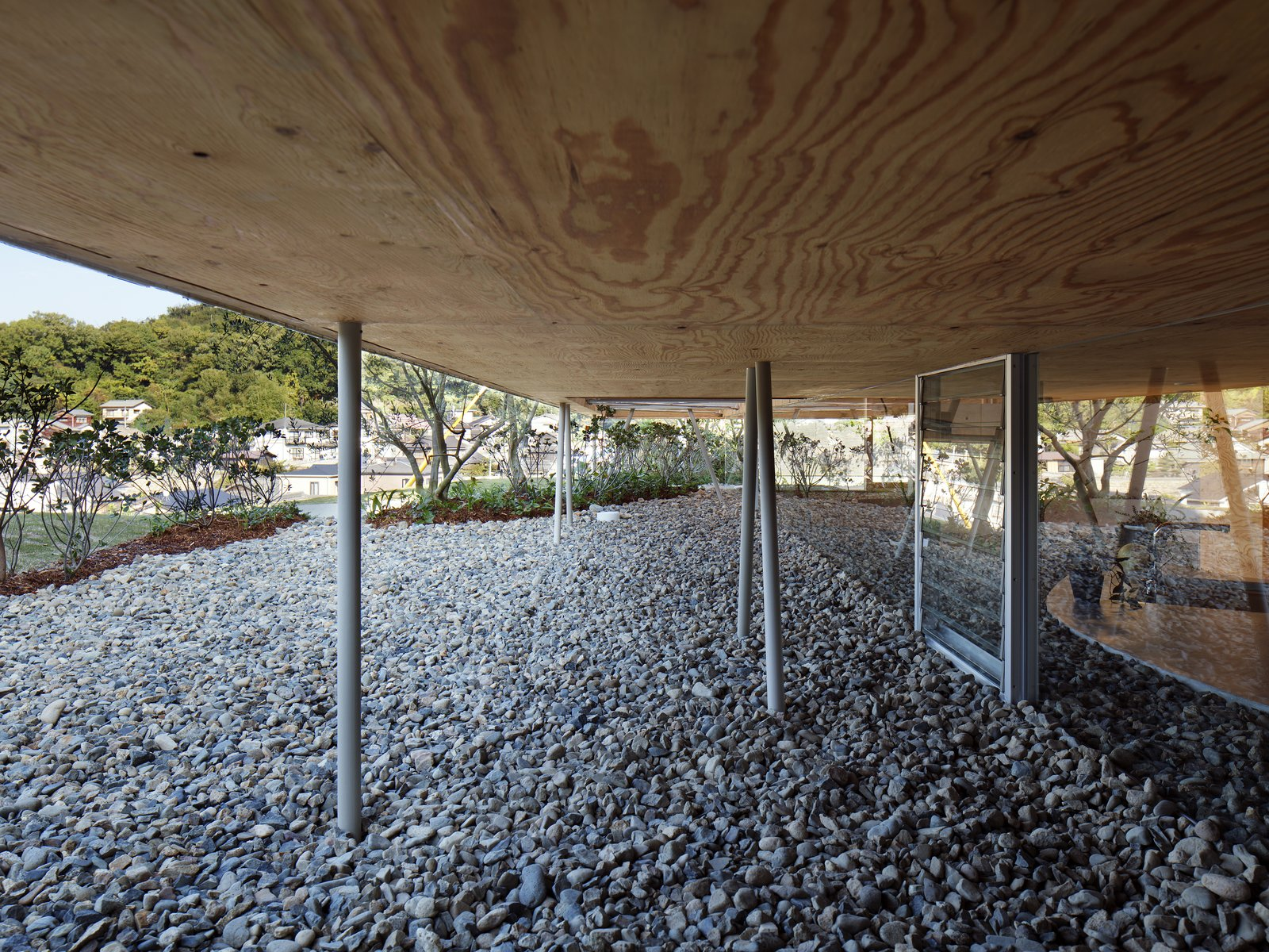 Exterior and House Building Type The upper volume is supported by slender, branch-like metal posts.  Photo 4 of 12 in This Japanese Home Has a Sunken Interior That Blends Into the Earth