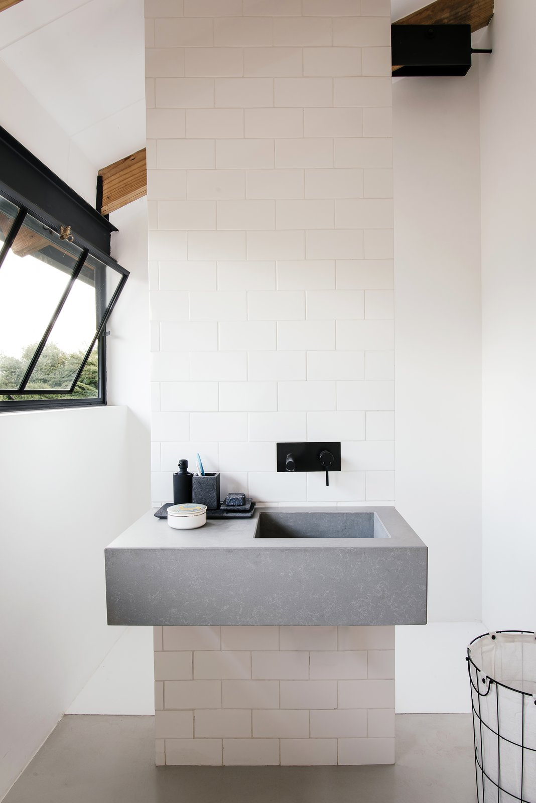 Bath, Concrete, Engineered Quartz, Vessel, Ceramic Tile, and Drop In A look at the simple, modern bathroom with a monolithic sink.    Best Bath Ceramic Tile Vessel Photos from A South African Architect Designs an Off-Grid, Modern Home For Her Parents