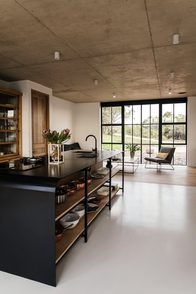 The industrial use of building materials continues to the interior closets, cupboards, and kitchen area.