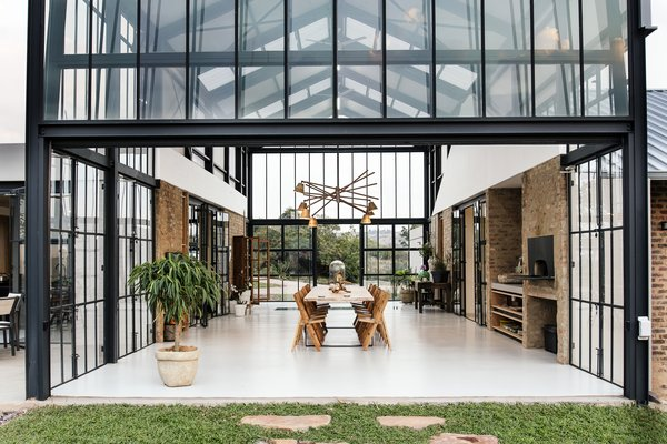 When the glass partitions are open, the passive heat from the conservatory is then released into the adjoining living spaces.