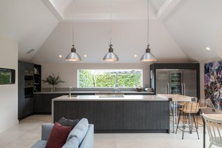 A streamlined, modern kitchen with shiplap joinery.