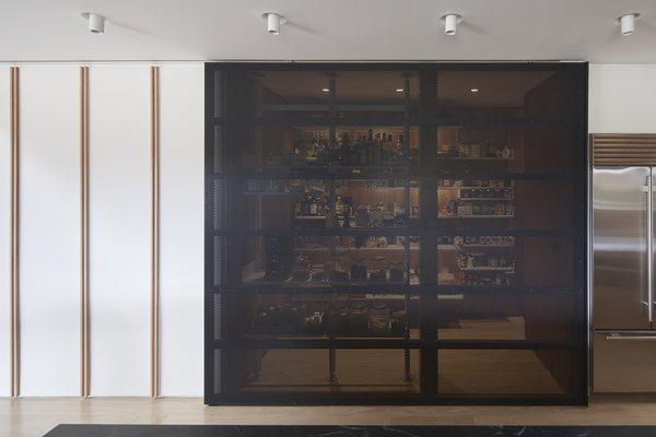 The New Kitchen Features A Super Pantry Concealed Behind Sleek Black Screen