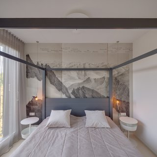 Mountain prints bring a little nature into the bedrooms.