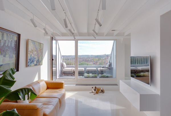 This Bright, White Duplex in Lithuania Showcases Art With Amazing Views