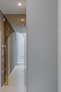A futuristic arched glass threshold.