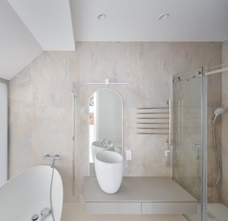 A bathroom is the only enclosed space on the upper level.