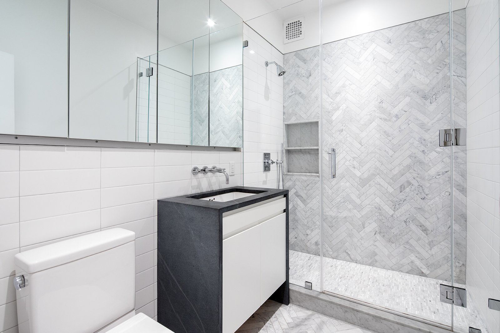 Bath, Two Piece, Enclosed, Marble, Ceiling, Recessed, Marble, and Undermount The bathroom on the second level.    Best Bath Two Piece Ceiling Recessed Photos from An Updated 1845 Brooklyn Home Hits the Market at $2.95M