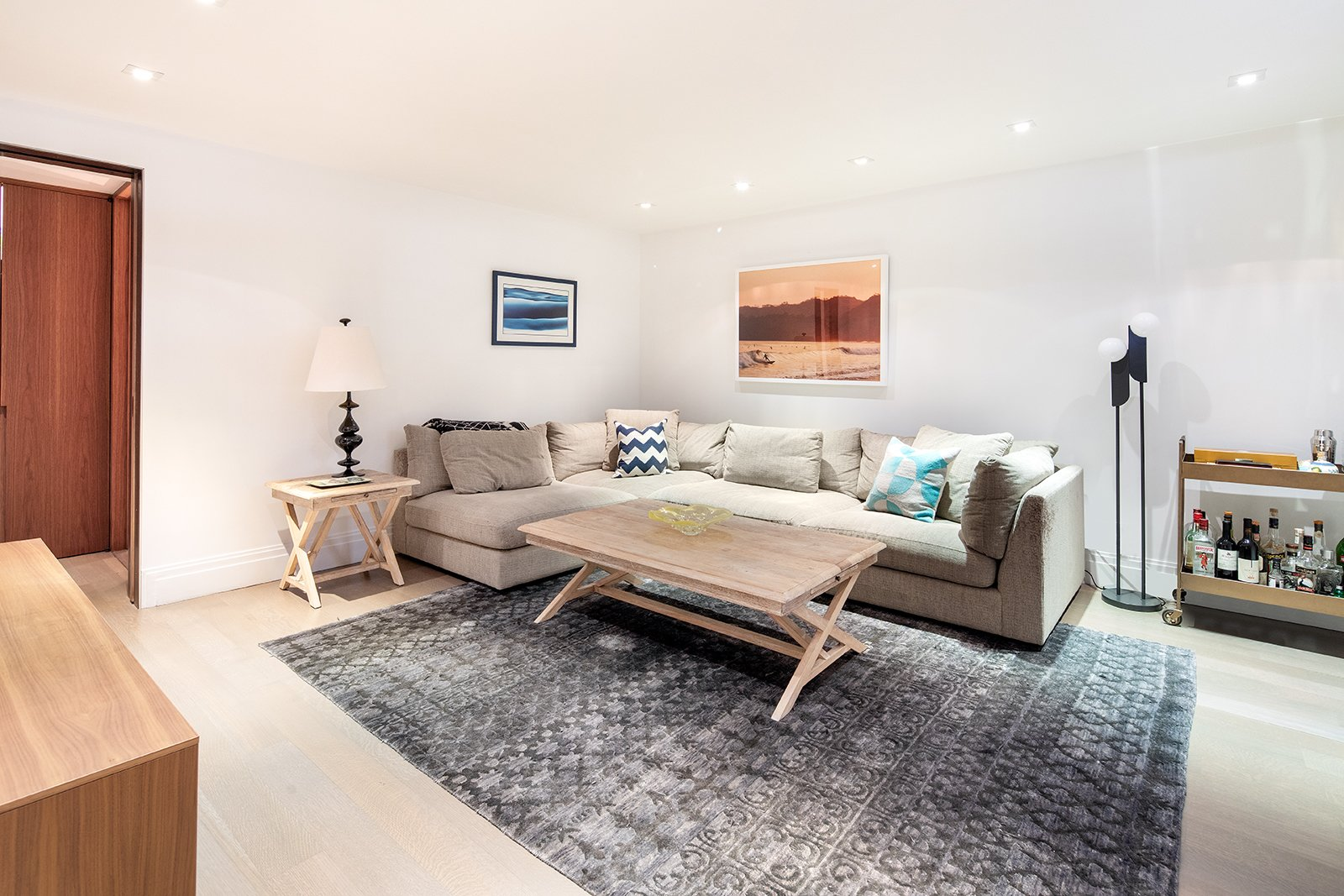 Living Room, Light Hardwood Floor, Sofa, Recessed Lighting, Table Lighting, End Tables, Coffee Tables, Floor Lighting, and Rug Floor The third bedroom is presently used as a family room.    Best Photos from An Updated 1845 Brooklyn Home Hits the Market at $2.95M