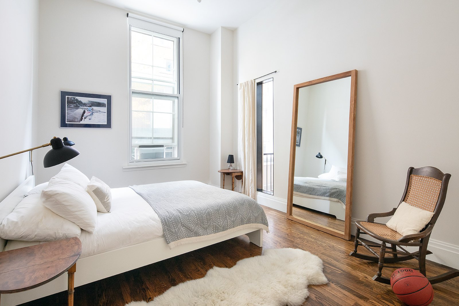 Bedroom, Bed, Table Lighting, Wall Lighting, Dark Hardwood Floor, Night Stands, and Chair A look at one of the three bedrooms.    Best Photos from An Updated 1845 Brooklyn Home Hits the Market at $2.95M