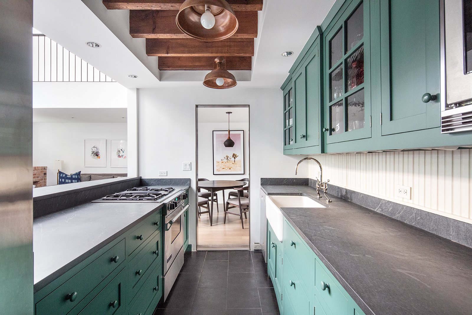 Kitchen, Marble Counter, Wall Oven, Cooktops, Drop In Sink, and Colorful Cabinet The kitchen features cheerful, sea-green cabinetry.    Photo 7 of 14 in An Updated 1845 Brooklyn Home Hits the Market at $2.95M