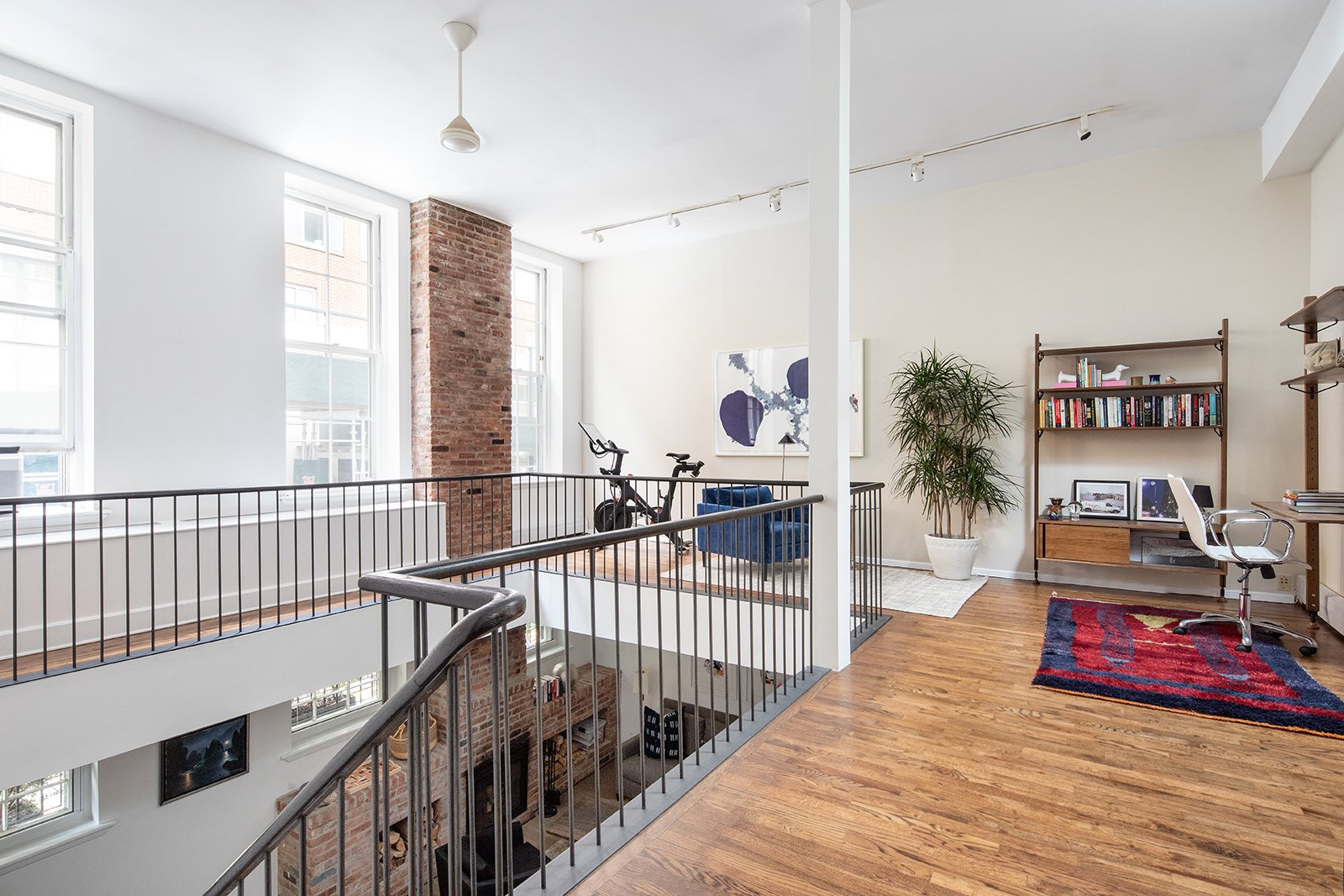 Office, Medium Hardwood, Chair, Study, Library, and Desk The wraparound mezzanine has a massive skylight. This space could be used for a variety of purposes, including being converted into a fourth bedroom.    Best Office Medium Hardwood Desk Photos from An Updated 1845 Brooklyn Home Hits the Market at $2.95M