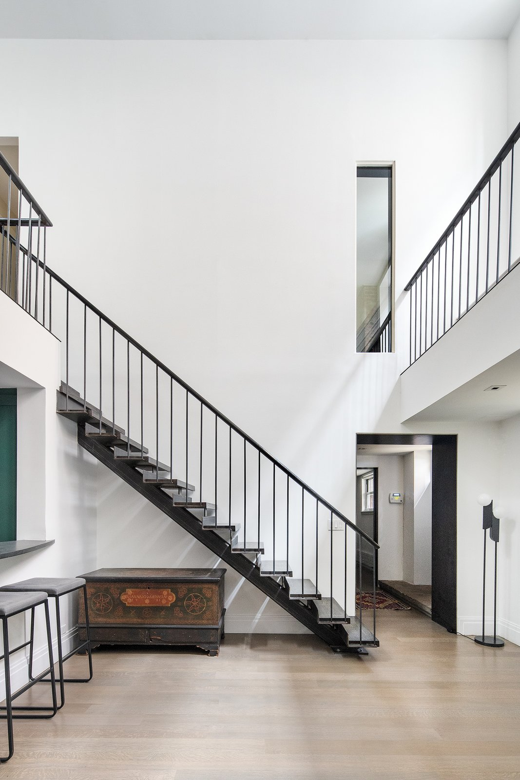 Staircase and Metal Railing Within the home, the ceiling heights range from 11 to 21 feet.     Photo 6 of 14 in An Updated 1845 Brooklyn Home Hits the Market at $2.95M