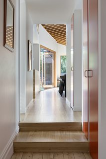American Oak timber flooring and a built-in sofa add continuity throughout the home.