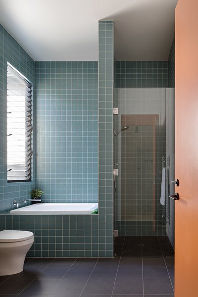Square Vogue Ceramica tiles give the bathroom a graphic punch.