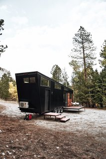 Land Ark RV's Draper is a midcentury modern-inspired tiny house with clean lines, a simple and elegant layout, and an angled ceiling.