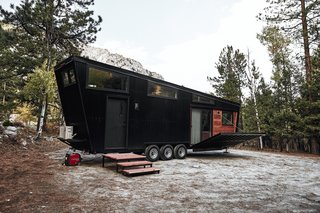 Land Ark RV used Cumaru—a renewable Brazilian hardwood—for the deck and the inset siding of this tiny home's exterior. The deck can be raised and lowered for transport in two minutes via an interior switch.
