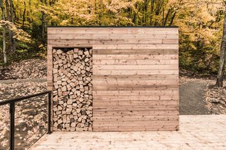 Outdoor firewood storage ensures that guests are well stocked.
