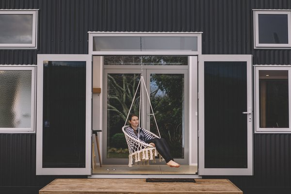 A small outdoor deck with a swing seat.