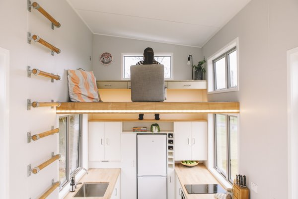 Tiny homes and shipping containers have inspired many homeowners to seek out home office ideas for small spaces, like the one pictured here. A clever loft makes the perfect home office space without overcrowding this diminutive abode by New Zealand–based company, Build Tiny.