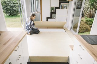 Floor panels open to reveal underfloor storage spaces.