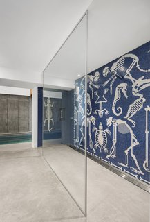 The pool is accessed by crossing the Paleolithic mosaic that adorns the walls of the shower.