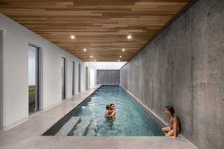The heart of the house features an indoor swimming pool where the kids can splash around—even in winter.