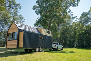 The trailer is set on wheels, so the home is easily relocatable, and can be registered as a caravan.  A power drill winds the slide-out inward and outward.