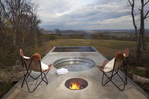 """The team installed an off-the-grid hot tub—known as a Dutch tub—that's heated by a wood fire. """"Essentially a couple of copper coils get wrapped around a fire pit with a hi and low input/output connected to the tub. Once the fire heats up, the hot tub really gets cookin'. At its hottest we have measured it at 104 degrees,"""" says Jimmy Mathew's, GreenSpur's Director of Development."""