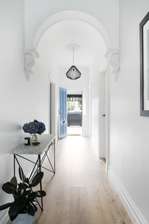 The home's entryway is bright white, with subtle Victorian accents.